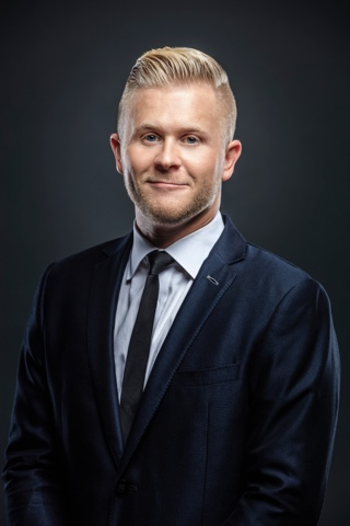 clint pulver portrait shot in business suit