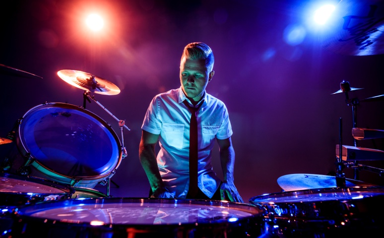 clint pulver in front of a professional colored drumset