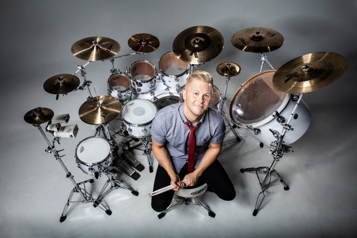 clint pulver in front of a white drum set