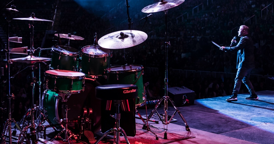 clint pulver on stage with drum set